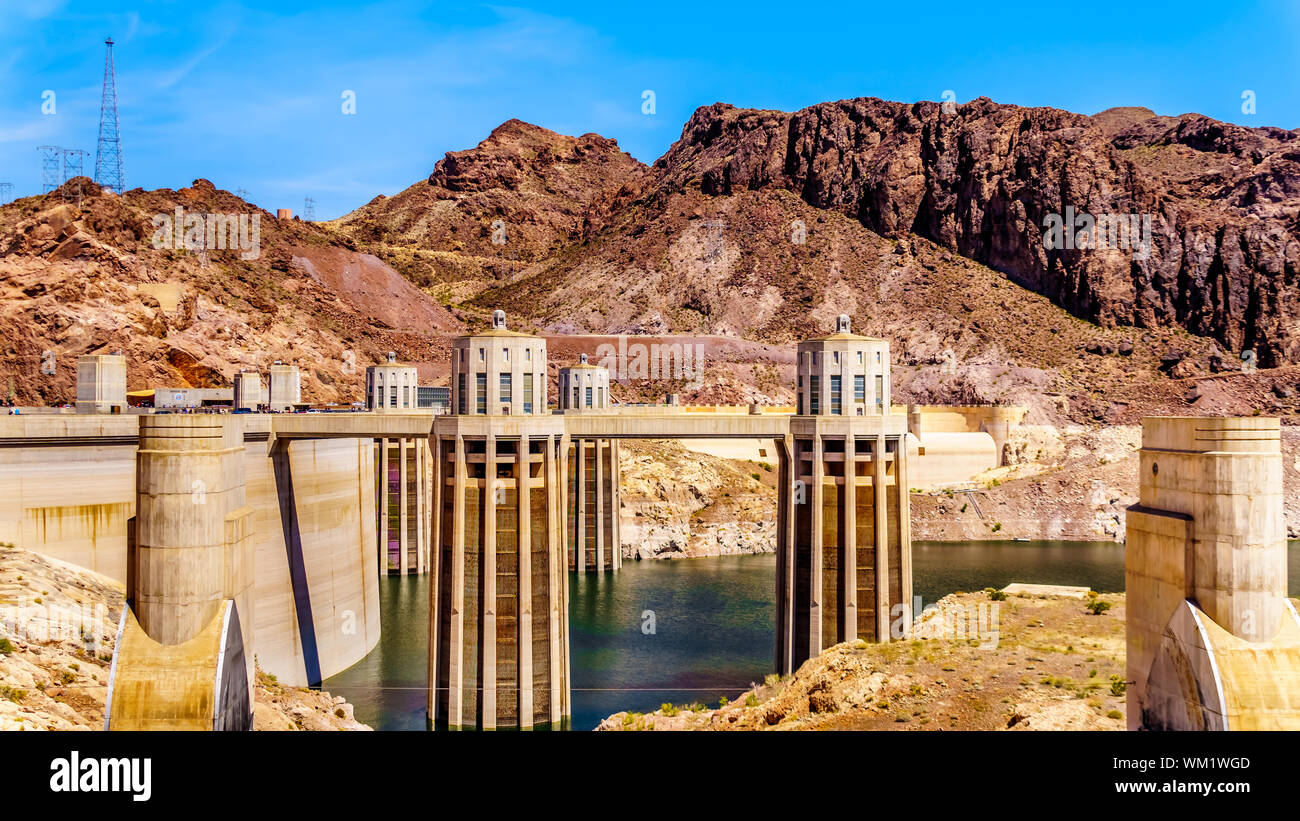 The four Intake Towers that supply the water from Lake Mead to the Power plant Turbines of the Hoover Dam hydroelectric power station at NV and AZ Stock Photo