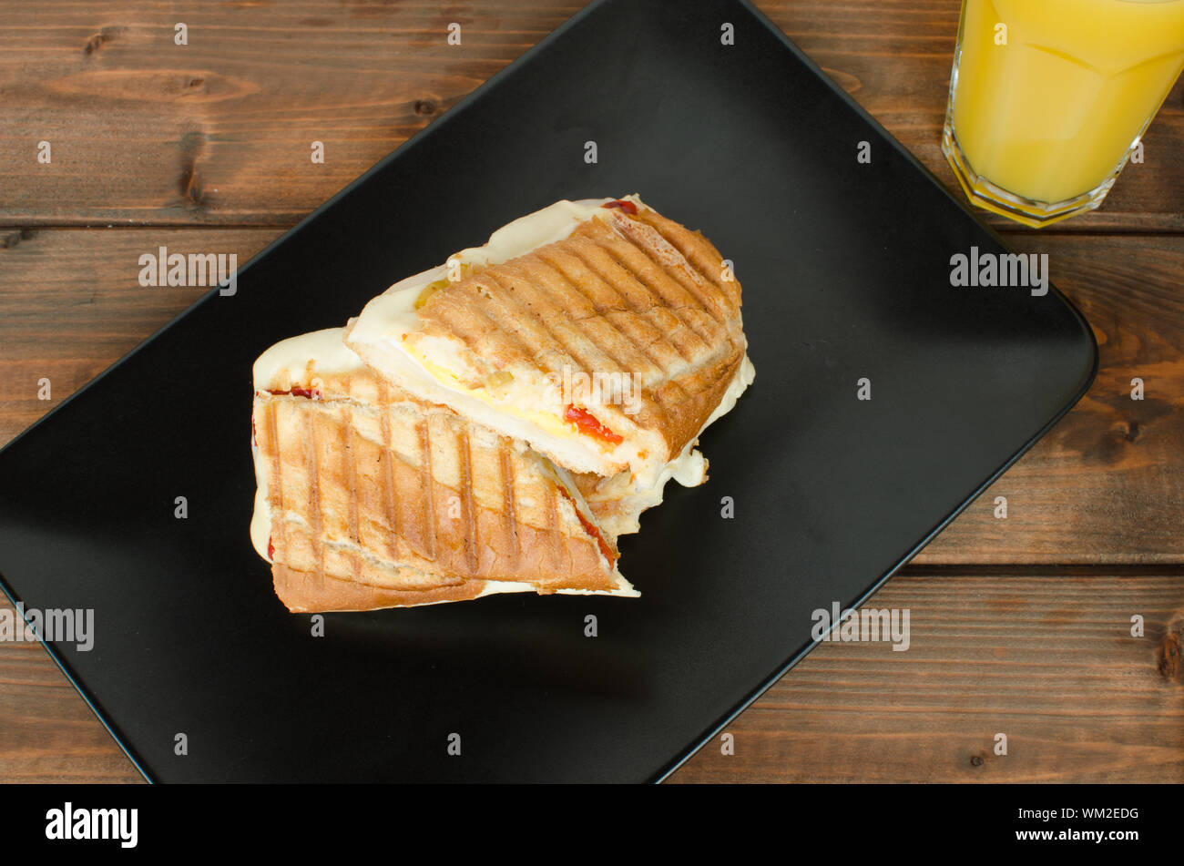 Panini sandwiches italien with paprica, cheese, eggs and ham Stock Photo
