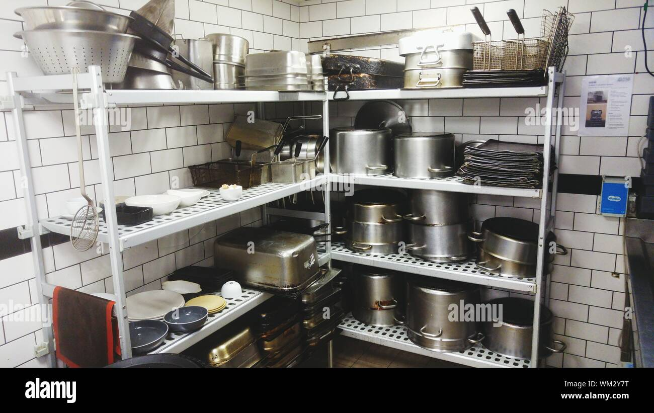 Utensils On Metallic Rack In Commercial Kitchen Stock Photo Alamy