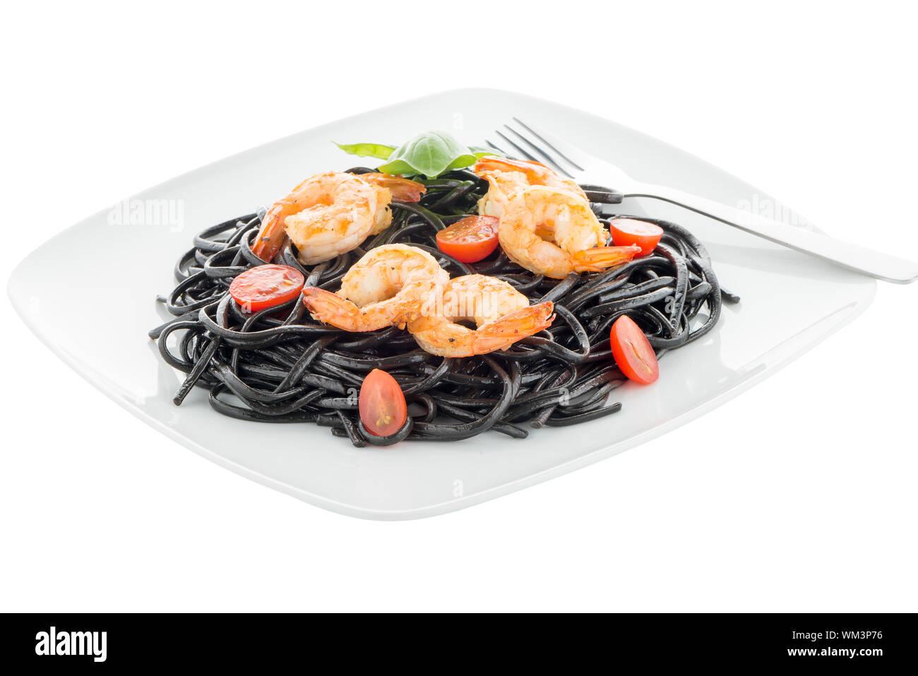 Black spaghetti with shrimps isolated on white Stock Photo
