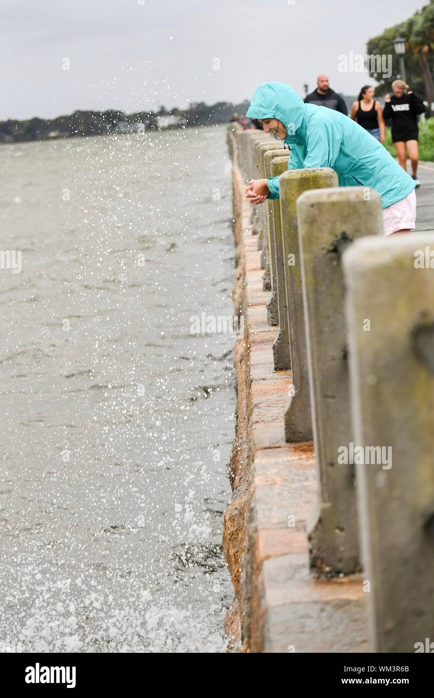 Charleston, South Carolina, USA. 04 September 2019. A young woman watches the water spray in Charleston Harbor on the High Battery ahead of Hurricane Dorian September 4, 2019 in Charleston, South Carolina. The slow moving monster storm devastated the Bahamas and is expected to reach Charleston as a Category 2 by Thursday morning.  Credit: Richard Ellis/Alamy Live News Stock Photo