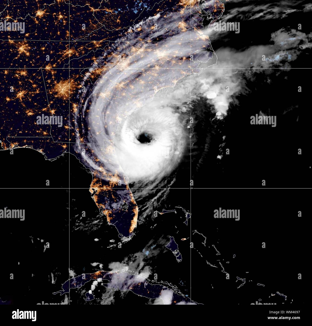 The NOAA GOES-16 satellite showing the night view of catastrophic Hurricane Dorian as it moves off the coast of Savannah, Georgia as a Category 2 storm September 4, 2019 in the Atlantic Ocean. Dorian struck the Bahamas as a Category 5 storm with winds of 185 mph and has now downgraded to Category 2 and is slowly creeping along the Atlantic coast of the U.S.  Credit: NOAA/Planetpix/Alamy Live News - Stock Photo
