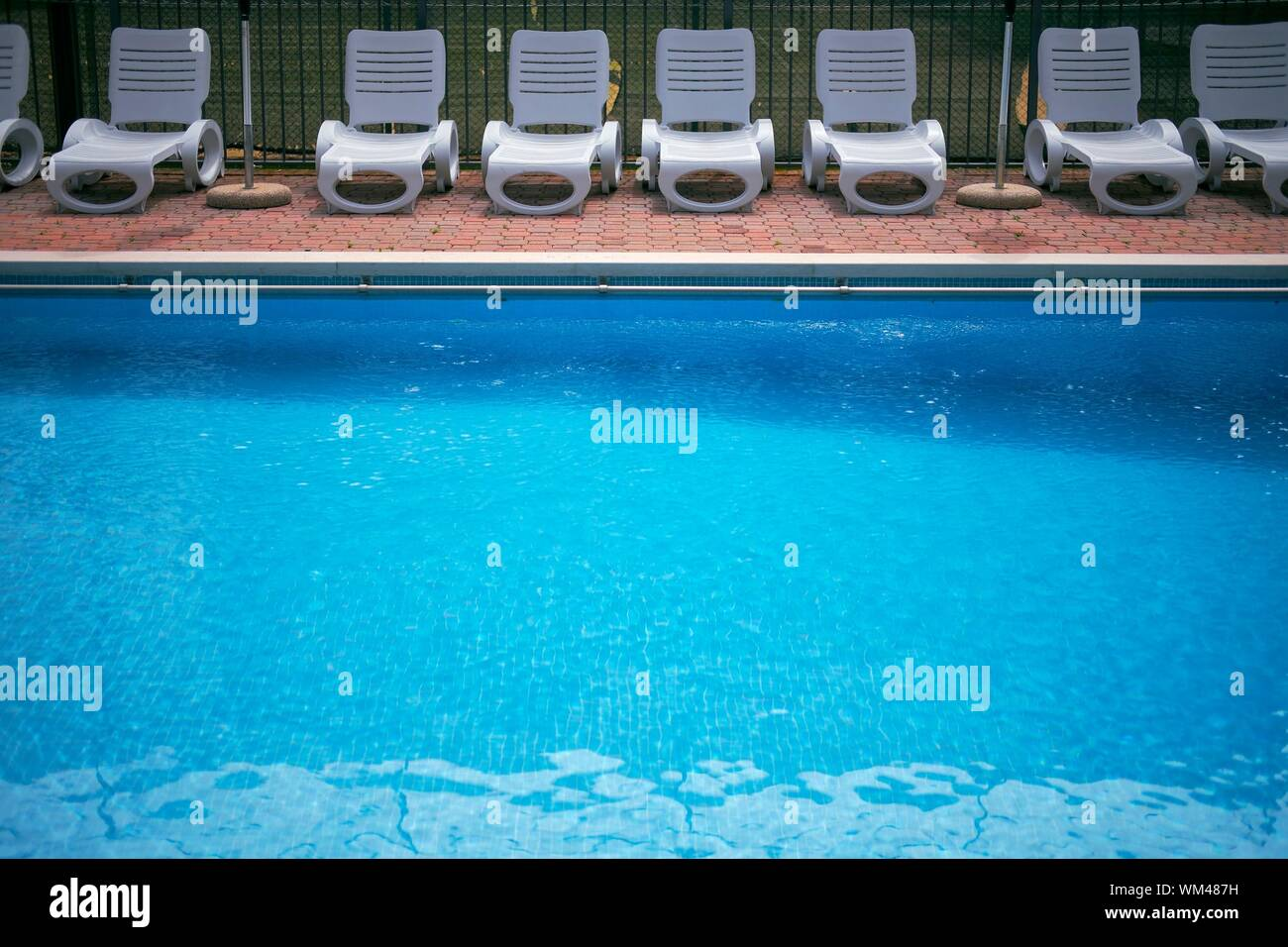Outdoor Natural Gas Fire Pit Table, High Angle View Of Swimming Pool With Lounge Chairs On Poolside Stock Photo Alamy
