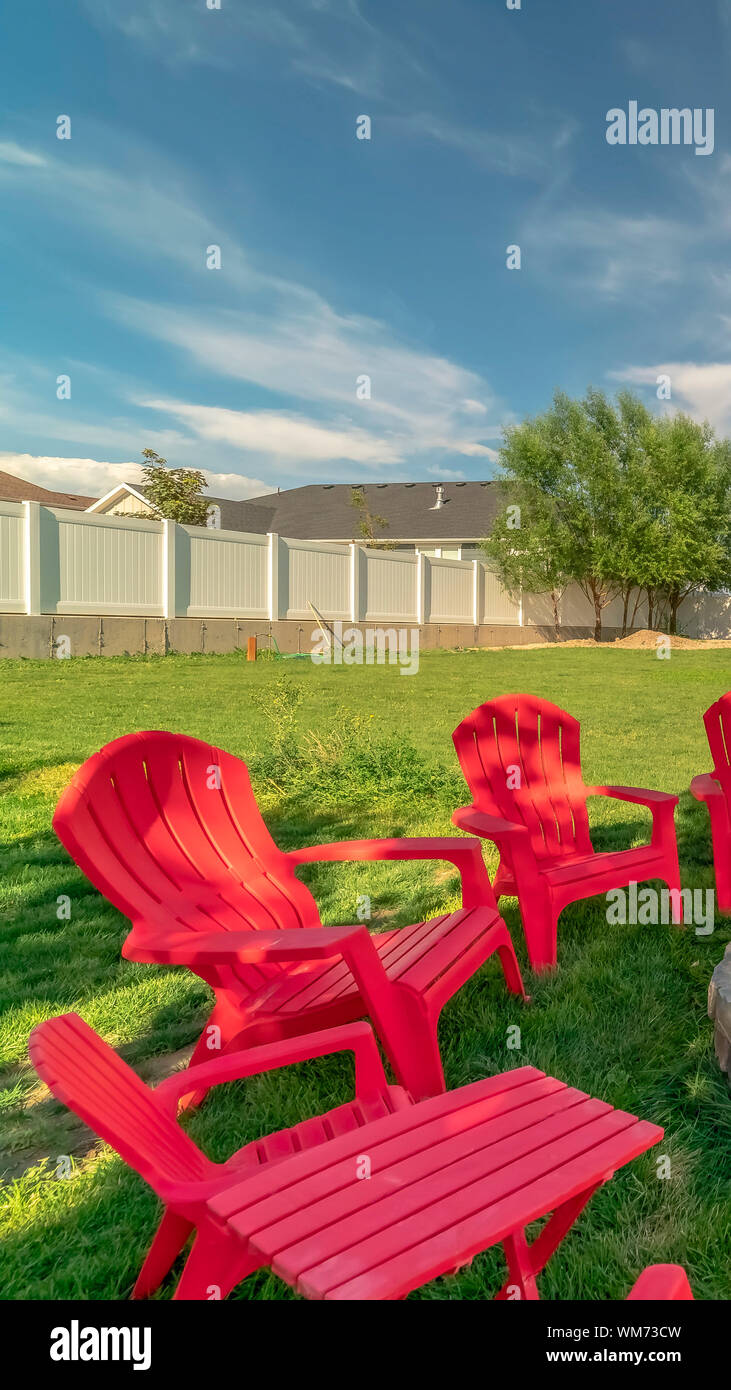 Vertical Frame Red Outdoor Chairs And Picnic Table With Bench Around A Circular Stone Fire Pit Stock Photo Alamy
