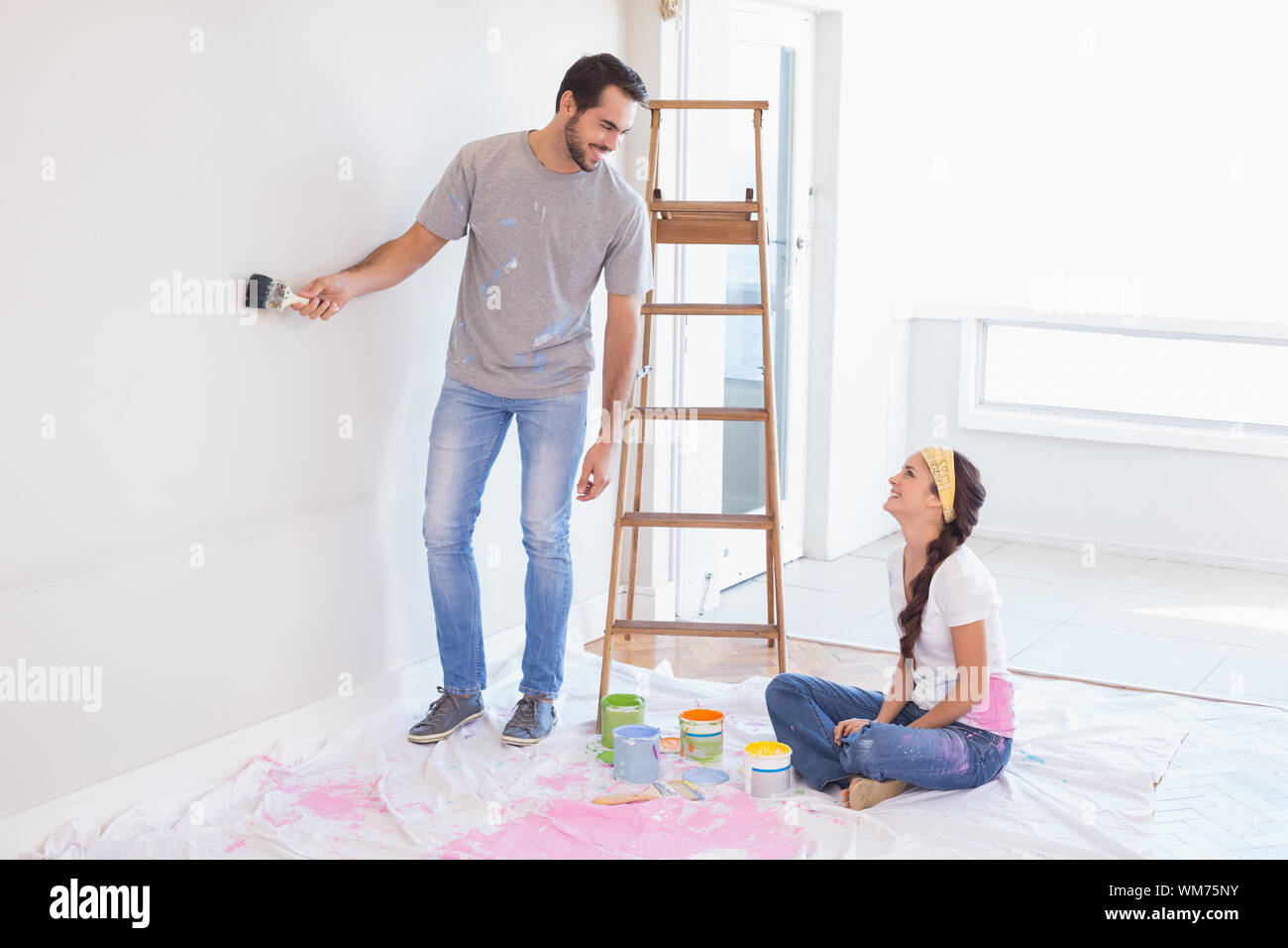 Cute couple redecorating living room in their new home Stock ...