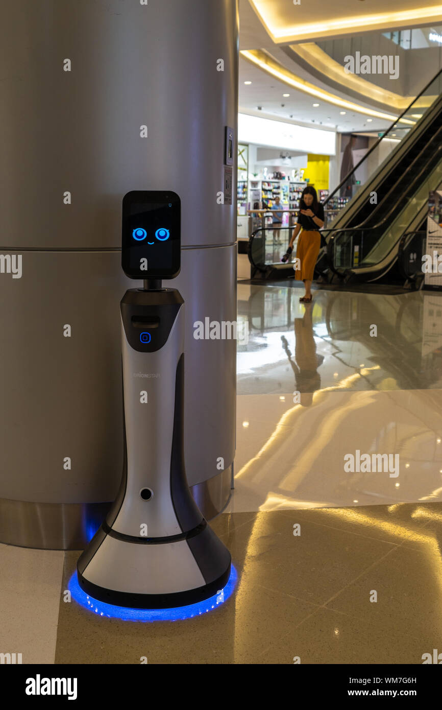 Smiling robot in service at a high end shopping mall in Shenzhen, China - Stock Photo