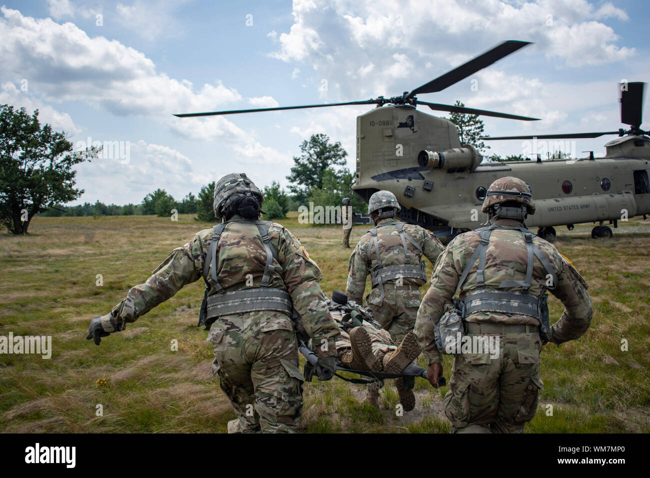 New York National Guard medics assigned to Headquarters Battery of the 1st Battalion, 258th Field Artillery conduct mass casualty training during an evacuation exercise with CH-47 Chinook helicopter aircrews from B Company, 3rd Battalion, 126th Aviation during the two units' annual training at Fort Drum, N.Y. July 29th, 2019. U.S. Army National Guard photo by Sgt. Matthew Gunther. Stock Photo