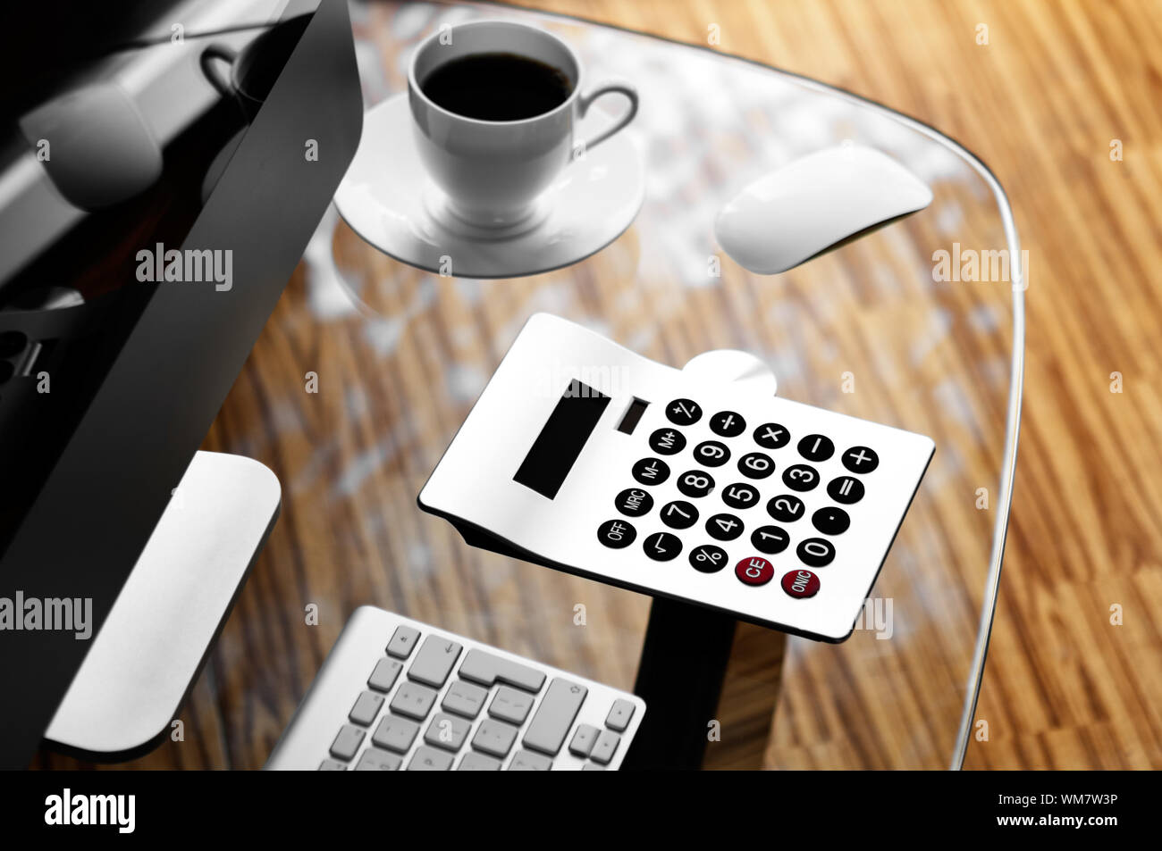 Computer Calculator And Cup Of Coffee On Glass Desk Stock Photo Alamy