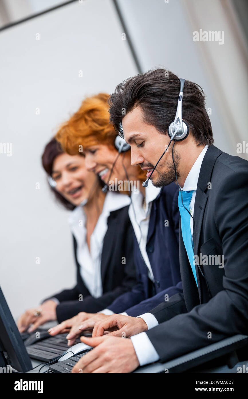friendly callcenter agent operator with headset telephone support service Stock Photo