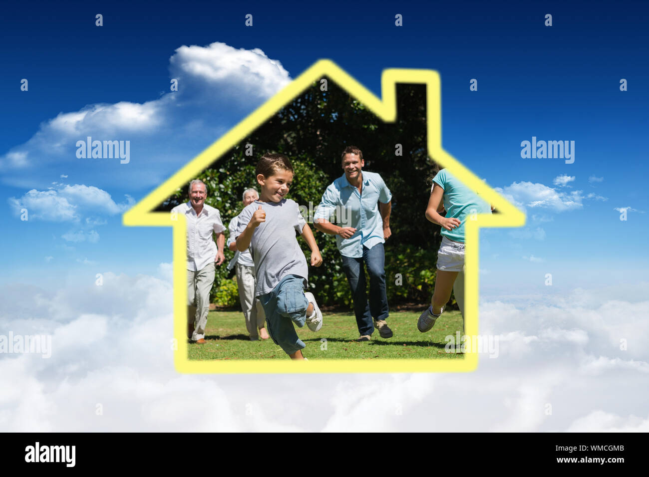 House outline against bright blue sky with clouds Stock Photo