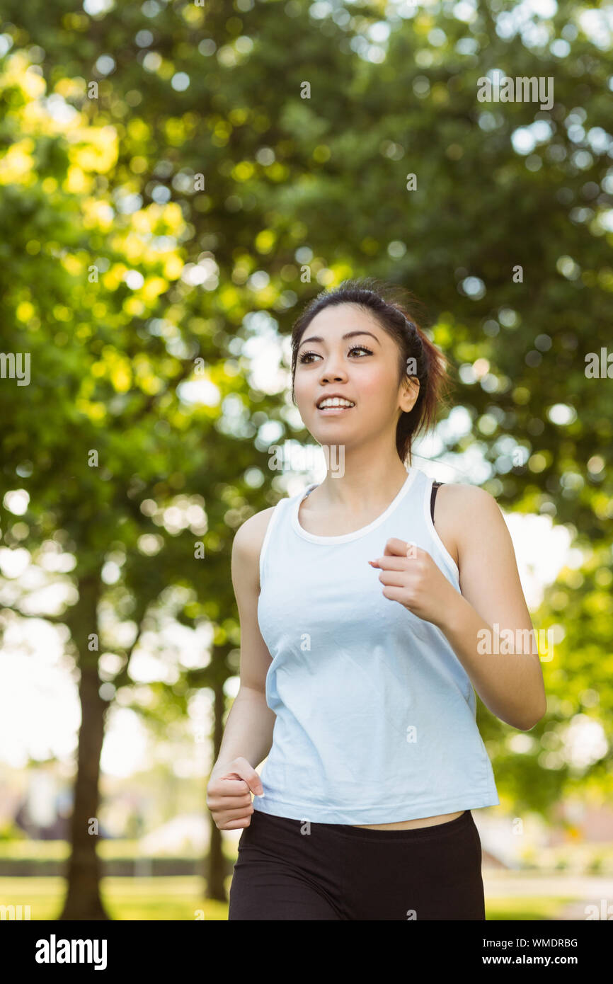 Healthy and beautiful young woman jogging in park Stock Photo