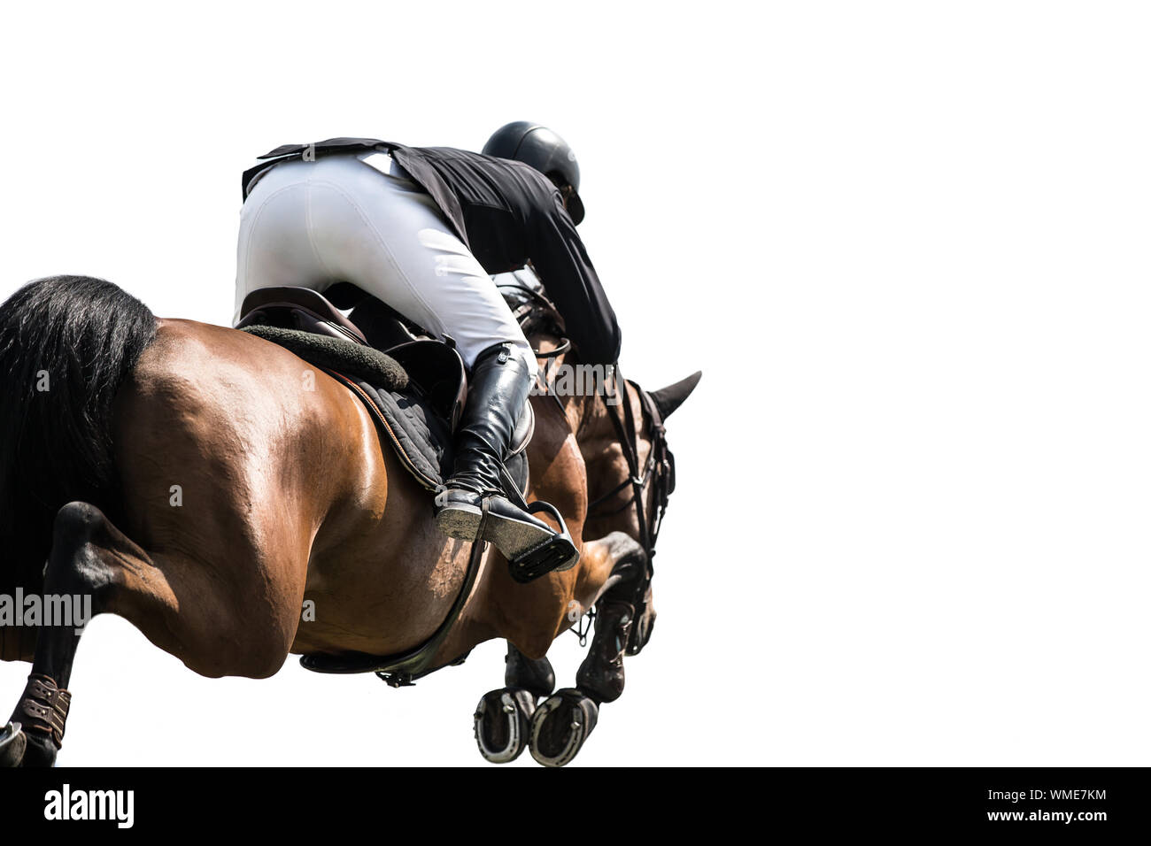 Rear View Of Person Riding Horse In Competition Stock Photo
