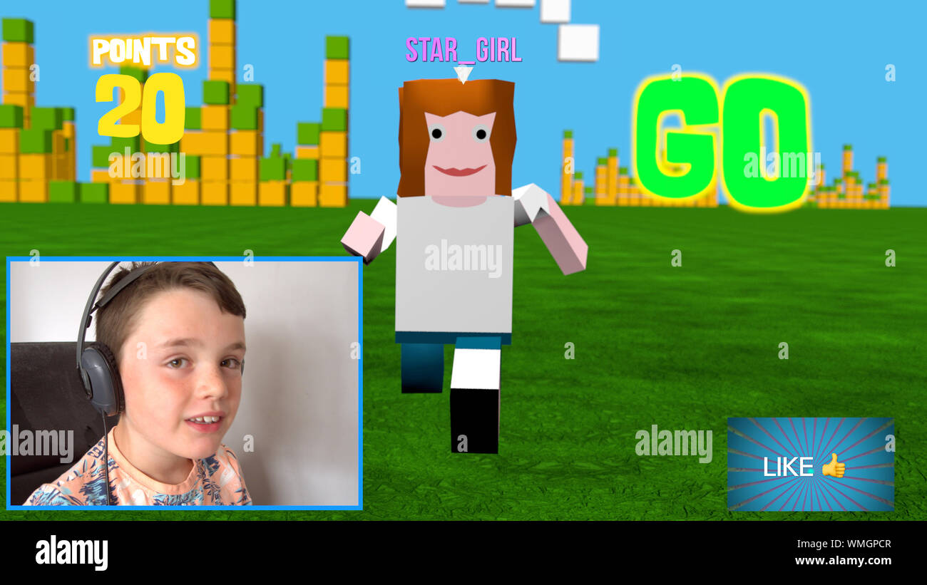 Young boy streaming an online 3D block style game as he uploads live video of him playing it Stock Photo