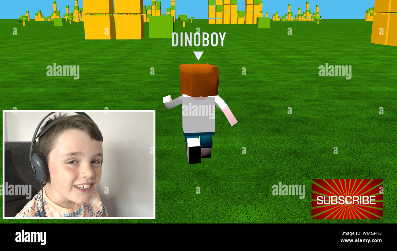 A young child streaming live video to his online channel. Playing a 3D block theme game Stock Photo