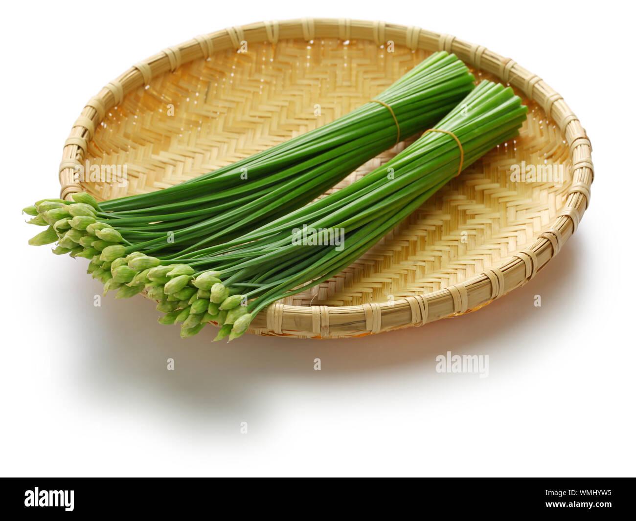 flowering garlic chives on bamboo basket Stock Photo