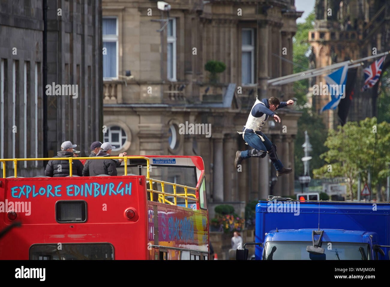 Edinburgh September 05 2019; A stuntman jumps from an open top bus onto a lorry during rehearsals for Fast and Furious 9 at Waterloo Place. Credit: Steven Scott Taylor/Alamy Live News Stock Photo