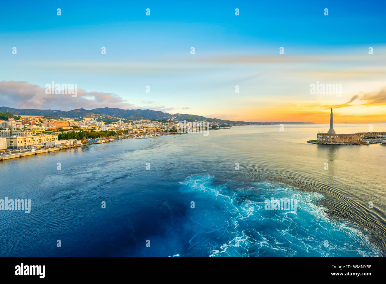 Sunrise from a cruise ship at the port of Messina, Italy on the island of Sicily in the Mediterranean Sea Stock Photo