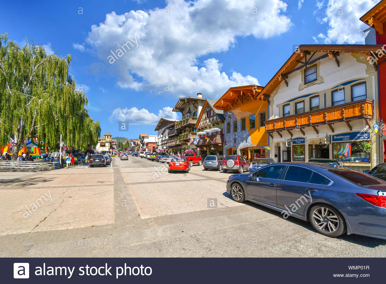 Cars and tourists fill the main street through the Bavarian themed town of Leavenworth, Washington, United States. Stock Photo