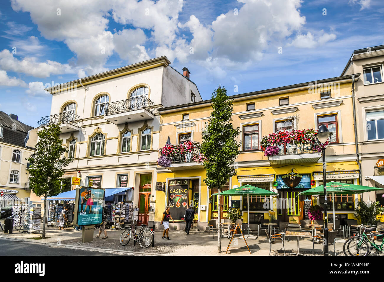 Tourists and locals enjoy a partly cloudy summer day in the coastal resort of Warnemunde, Germany, on the shores of the Baltic Sea. Stock Photo