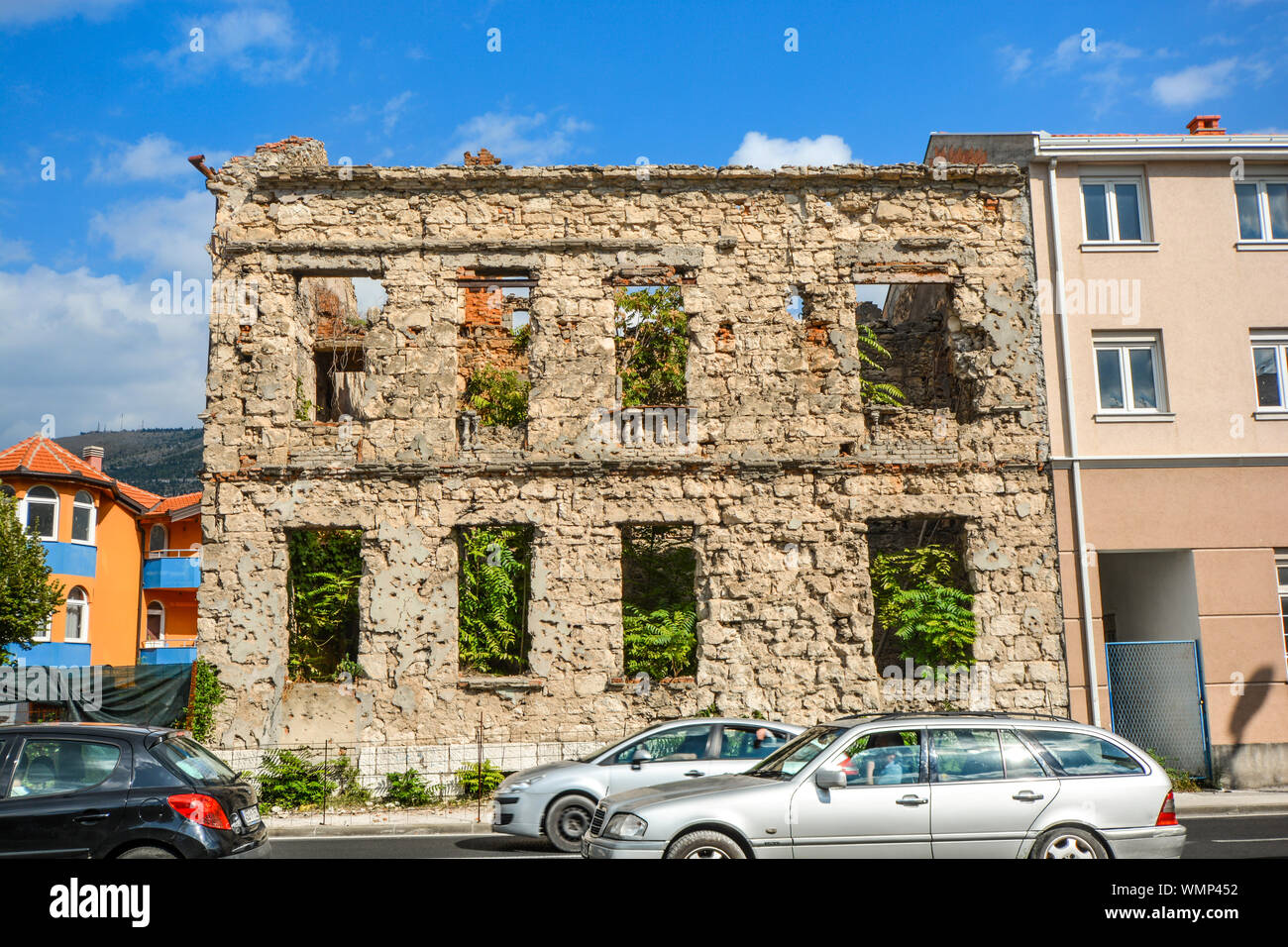 A building lies abandoned after being destroyed in the Balkans war in the town of Mostar, Bosnia and Herzegovina Stock Photo