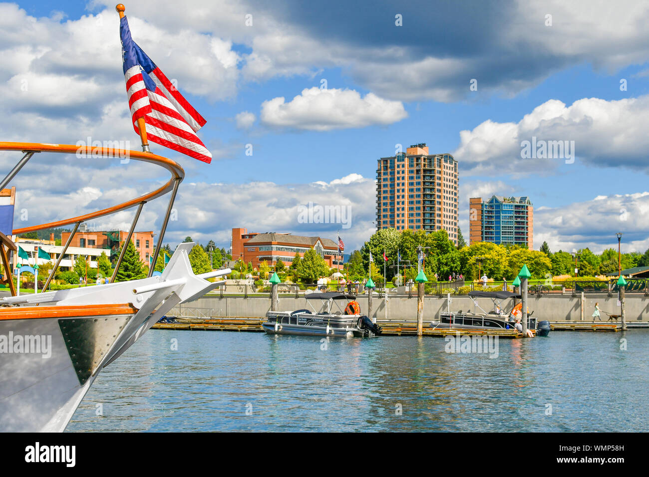 Tourists and locals enjoy the annual wooden boat show at the boardwalk in the mountain town of Coeur d'Alene, Idaho, in the Inland Northwest. Stock Photo