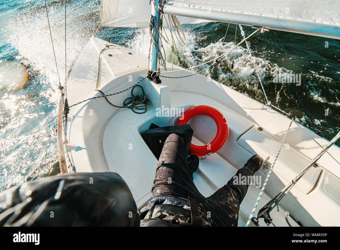 Waves spraying on the deck of a small yawl during a windy trip on the ocean Stock Photo