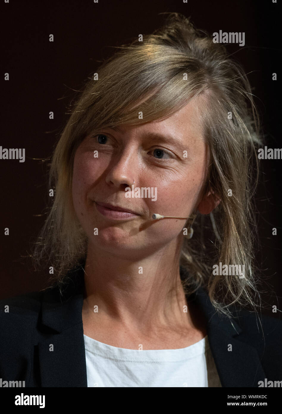 """Berlin, Germany. 05th Sep, 2019. Luise Neumann-Cosel, Campact Campaign Team Leader, sits in a panel discussion on """"Climate Crisis and Future Mobility"""". Credit: Christophe Gateau/dpa/Alamy Live News Stock Photo"""