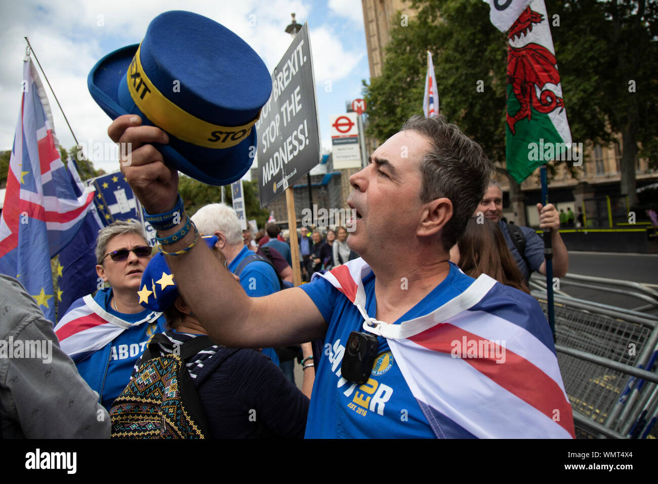 Anti Brexit protester Steve Bray has his hat taken and thrown away by Leave protesters in Westminster on the day that Parliament reconvenes after summer recess to debate and vote on a bill to prevent the UK leaving the EU without a deal at the end of October, on 3rd September 2019 in London, England, United Kingdom. Today Prime Minister Boris Johnson will face a showdown after he threatened rebel Conservative MPs who vote against him with deselection, and vowed to aim for a snap general election if MPs succeed in a bid to take control of parliamentary proceedings to allow them to discuss legis - Stock Photo