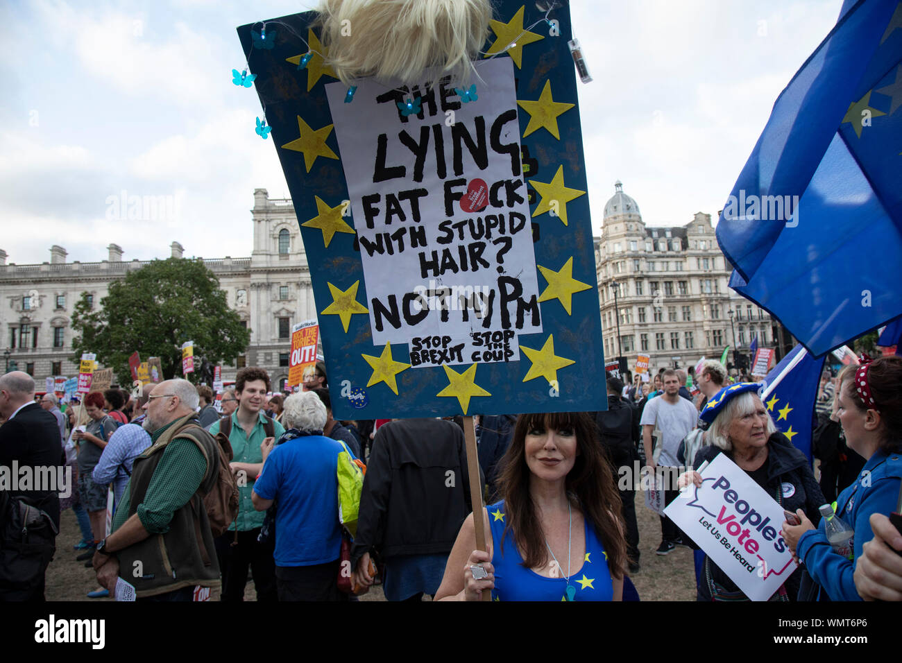 Anti Brexit protesters with messages against Boris Johnson and the Tory government to Stop Brexit, Stop the Coup and Pro Democracy at a demonstration organised by Peoples Vote in Westminster on the day that Parliament reconvenes after summer recess to debate and vote on a bill to prevent the UK leaving the EU without a deal at the end of October, on 3rd September 2019 in London, England, United Kingdom. Today Prime Minister Boris Johnson will face a showdown after he threatened rebel Conservative MPs who vote against him with deselection, and vowed to aim for a snap general election if MPs suc - Stock Photo