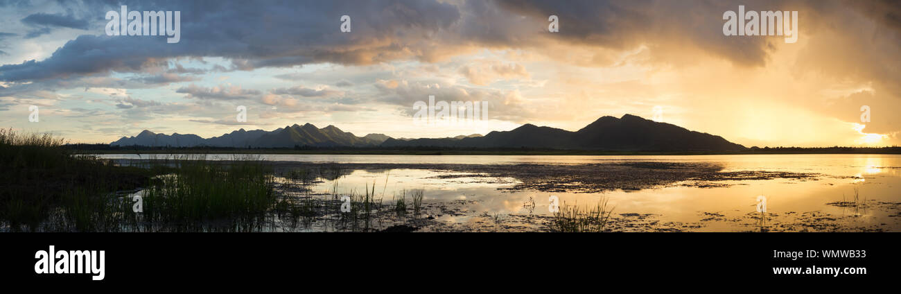 Panoramic View Of Lake Against Sky During Sunset Stock Photo