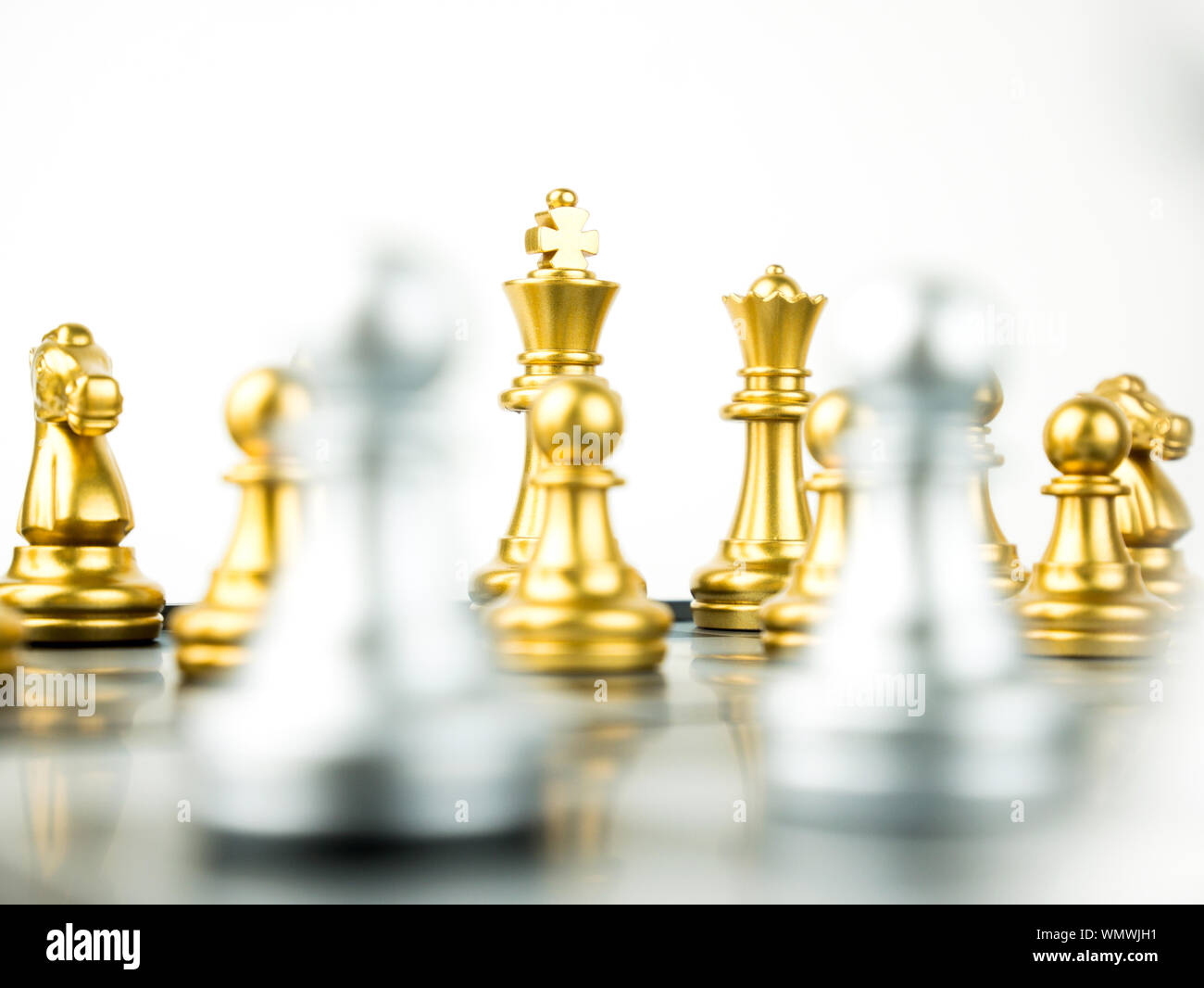 Gold and Silver King and Knight of chess setup on white