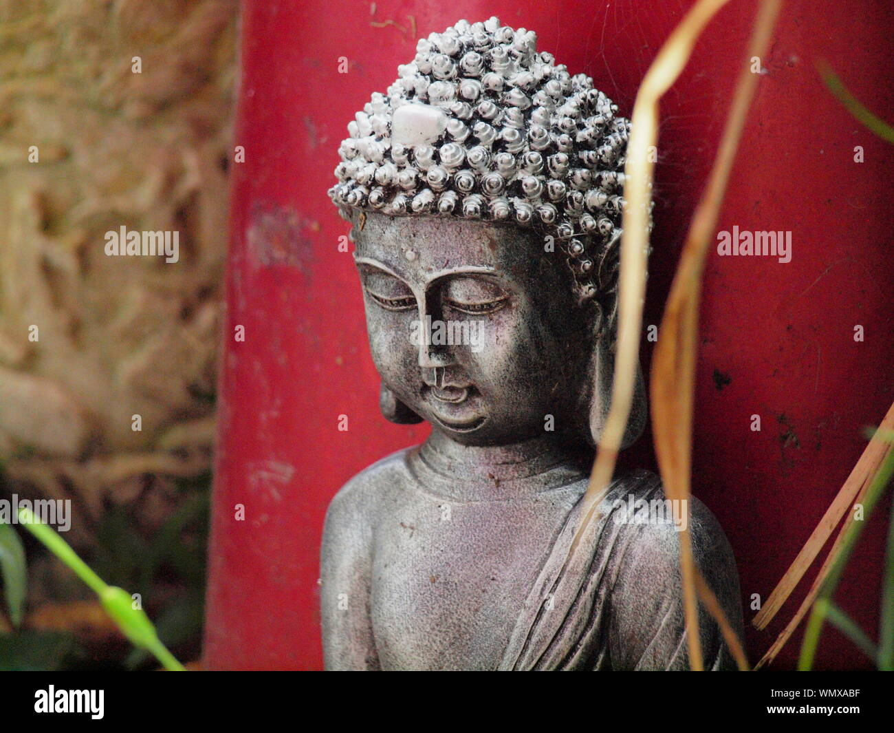 Close up upper body photograph of a contemplating / meditating buddha figure Stock Photo
