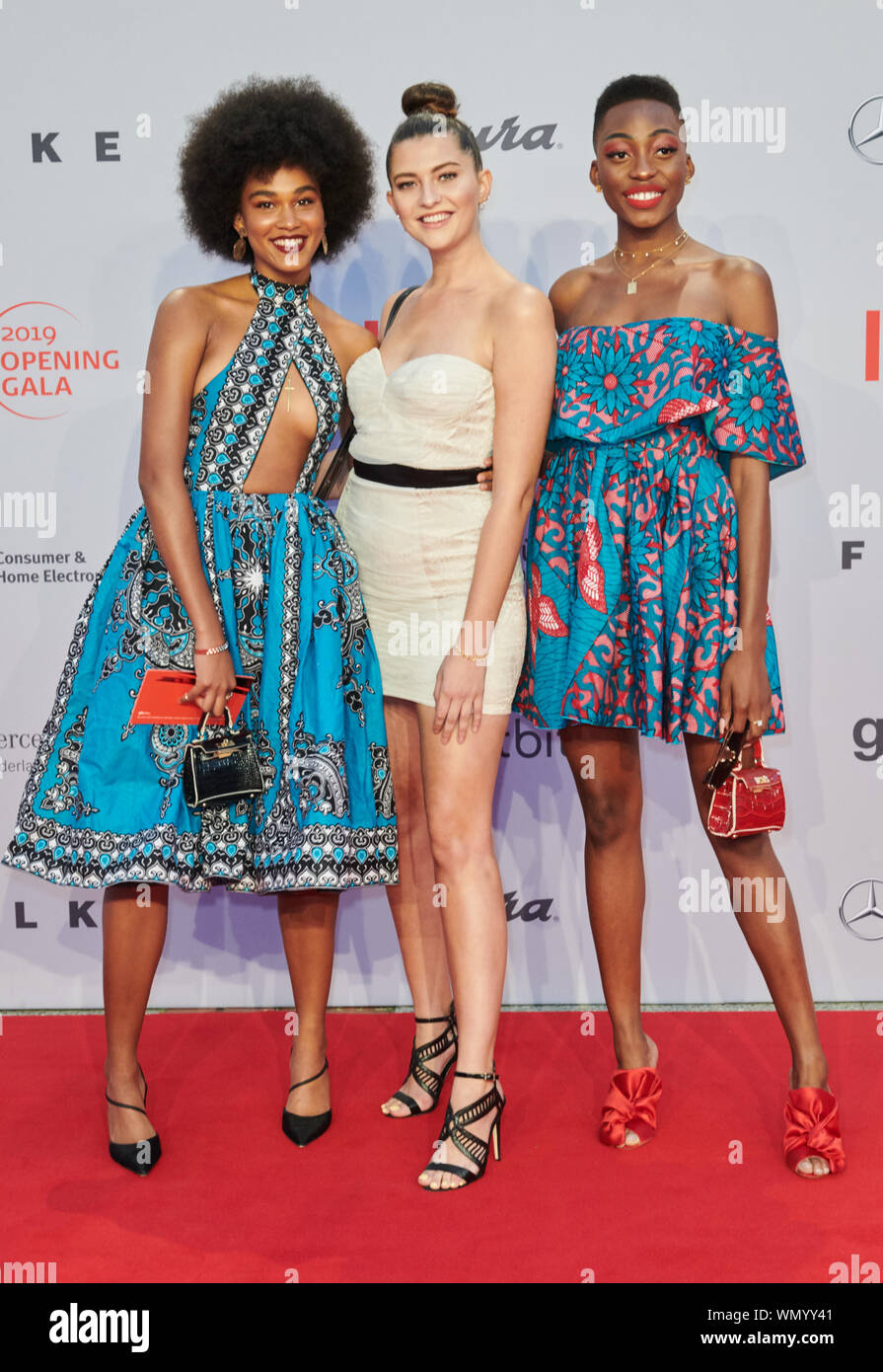 Berlin, Germany. 05th Sep, 2019. The models Georgette Tripes, Fata Hasanovic and Toni Dreher-Adenuga (l-r) come to the gala of the IFA opening. Credit: Annette Riedl/dpa/Alamy Live News Stock Photo