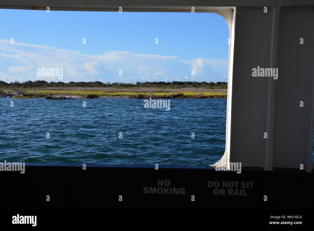 Hatteras Island passes by outside the window of the Hatteras-Ocracoke car ferry on the Outer Banks of North Carolina. Stock Photo