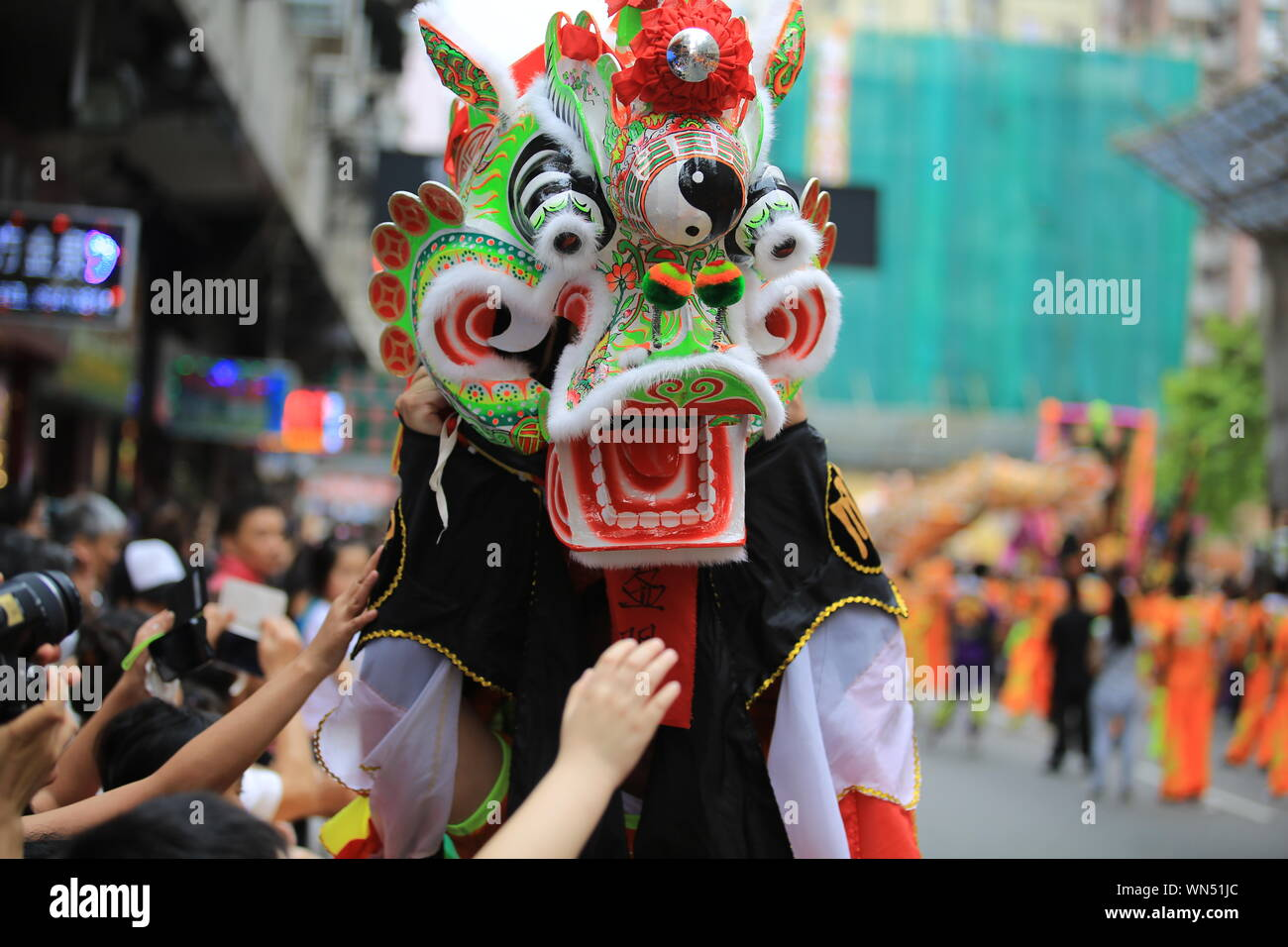 Close-up Of Person Wearing Costume In City During Event Stock Photo