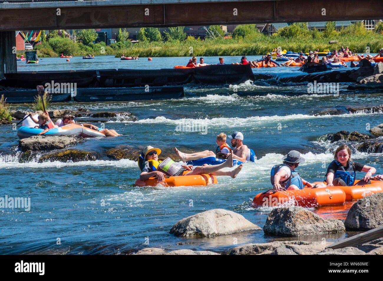 Tubing In The Deschutes River In Bend Oregon Stock Photo