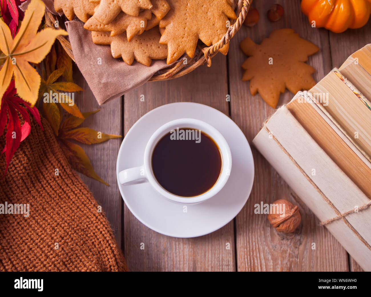 Composition With Cup Of Coffee Autumn Leaves Pumpkin Homemade Cookies And Books On The Wooden Table Autumn Concept Top View Stock Photo Alamy