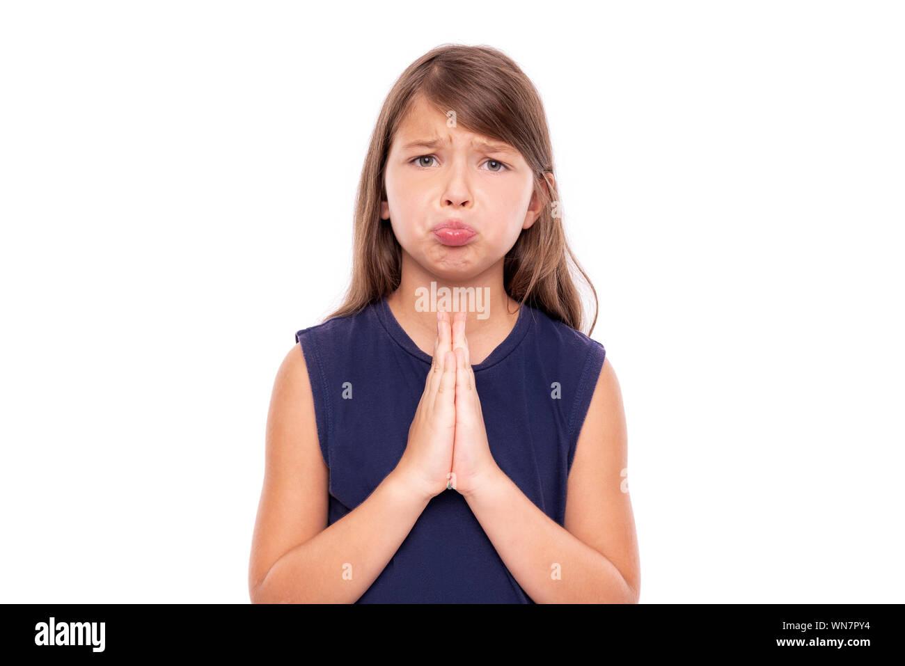 Little girl folded her hands in prayer. Stock Photo