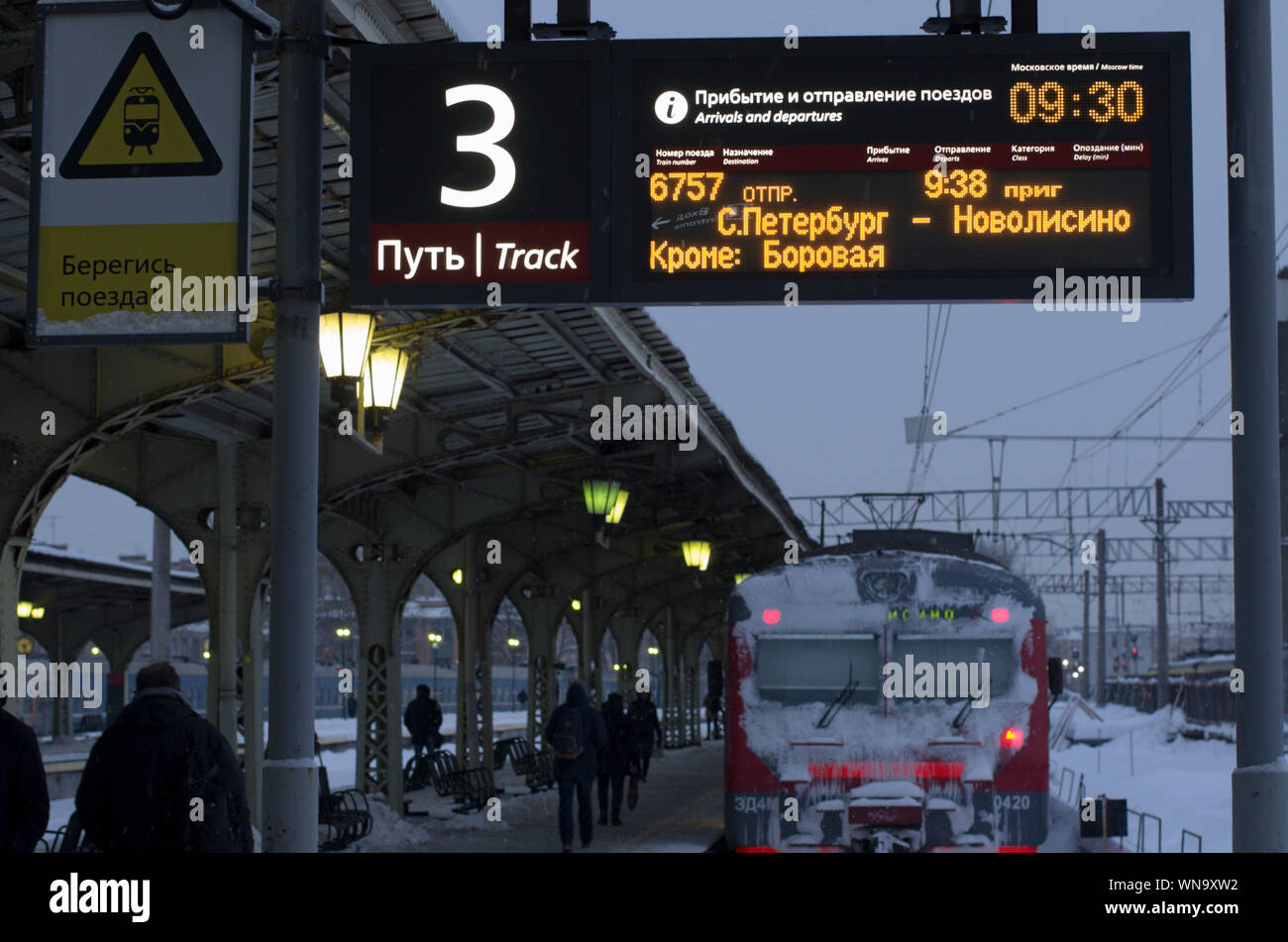 Vitebsky railway station,Saint Petersburg,Russia - January 24, 2019: Luminous scoreboard with the schedule of trains in Russian and duplication in Eng Stock Photo
