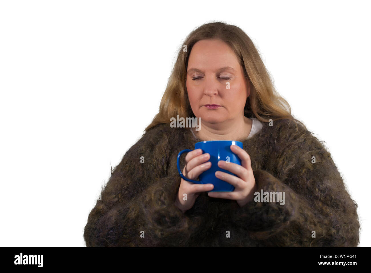 Woman Holding Blue Cup Against White Background Stock Photo