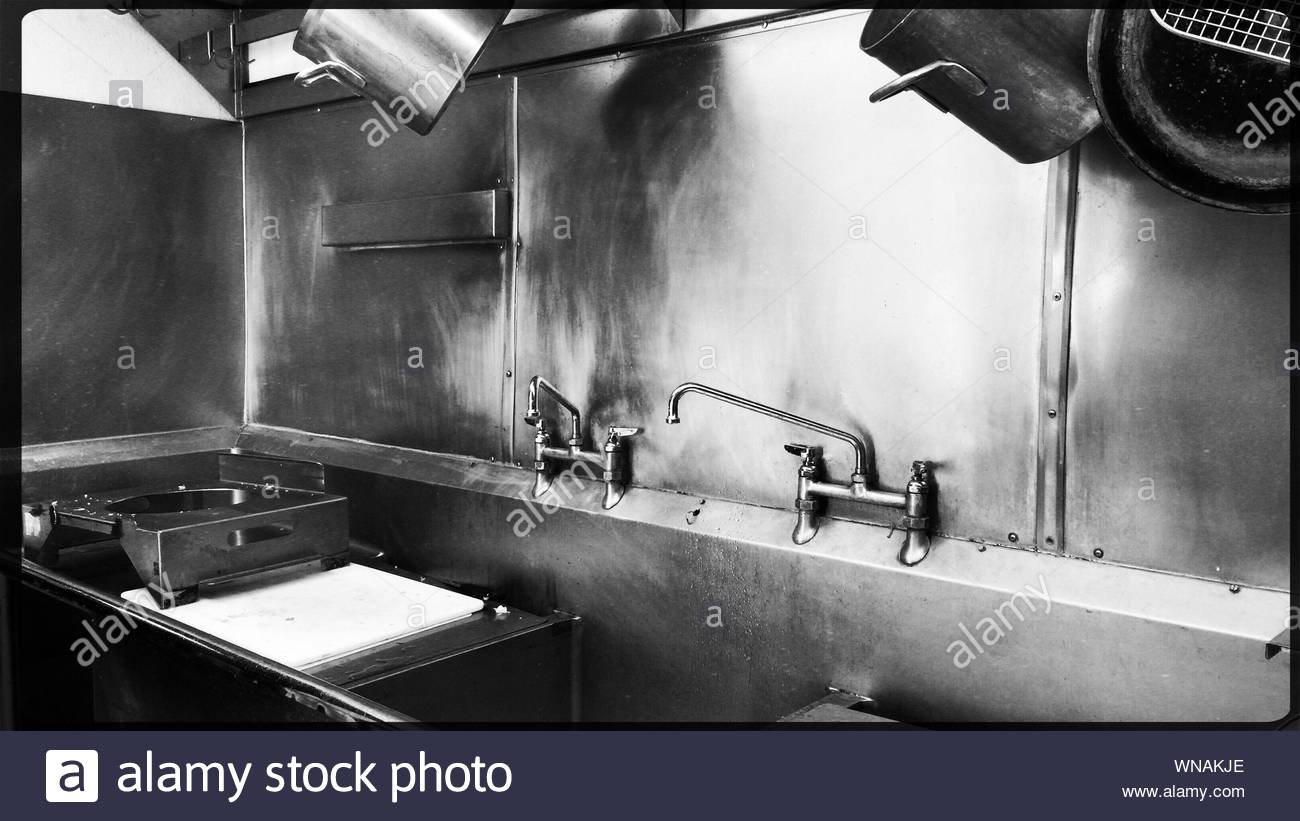 Empty Commercial Kitchen With Metal Walls And Kitchen ...