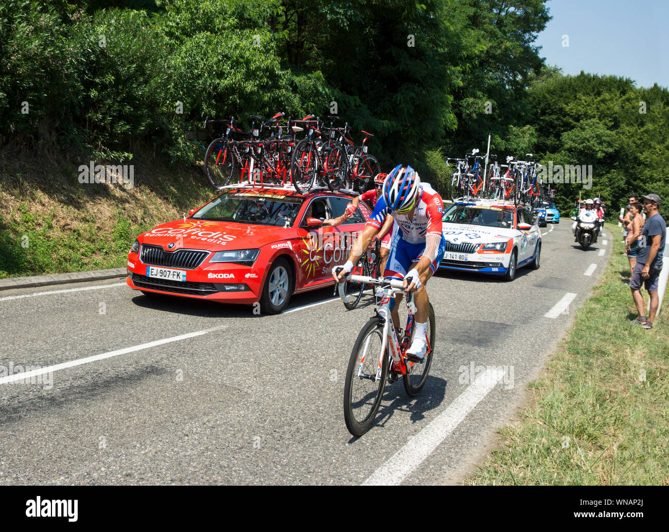 The 2018 Tour de France cycling race.At the back of the peloton near the market town of Maurbourguet. Hautes-Pyrenees.Southwest France. Stock Photo