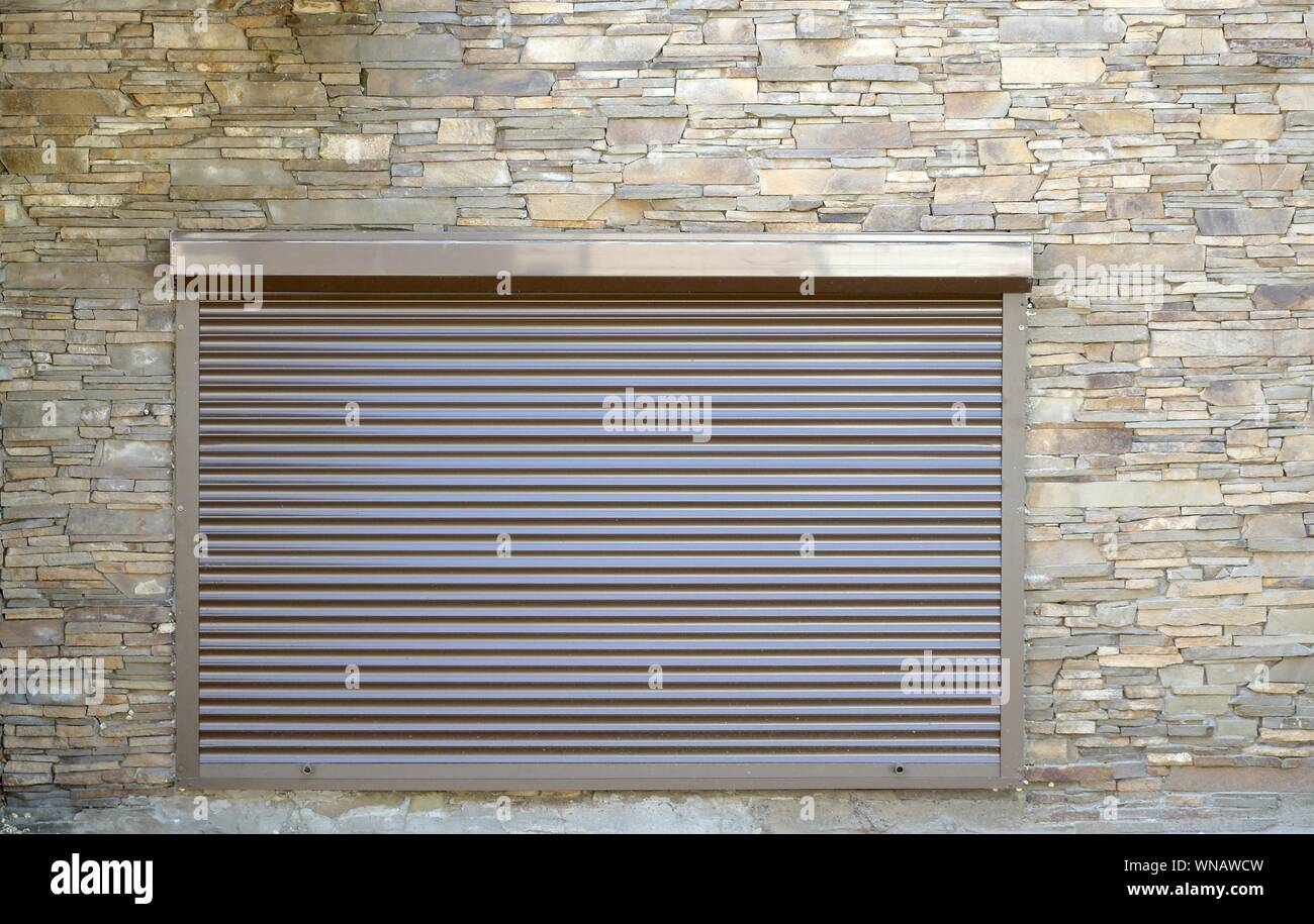 A Window With Brown Metal Rolling Shutters Wall Decoration