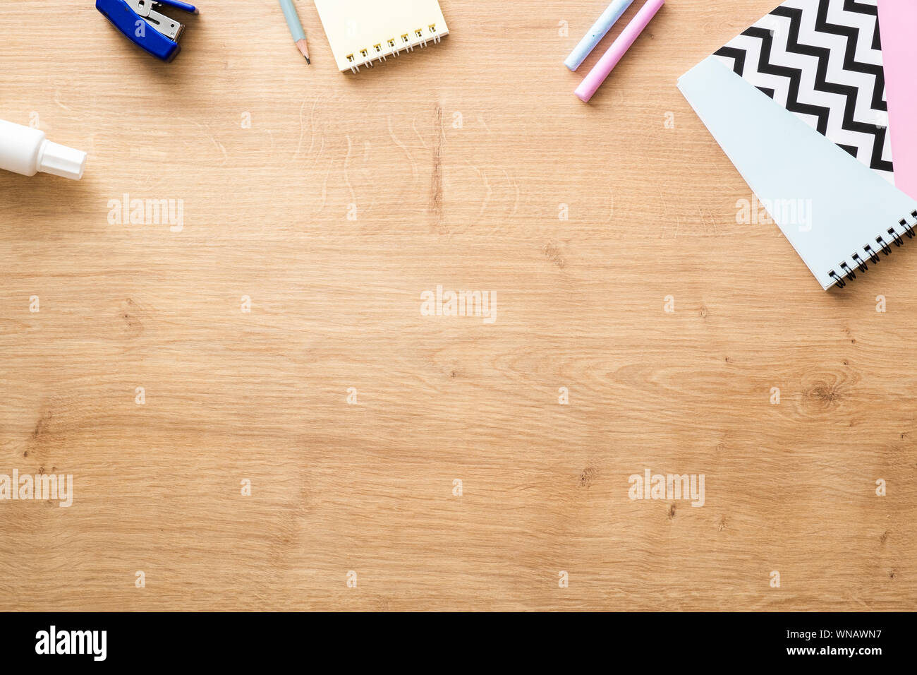 School supplies on wooden desk table background. Back to ...