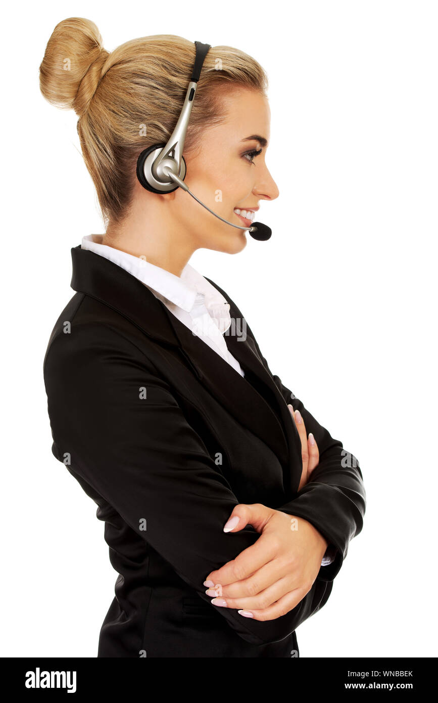 Happy young businesswoman with headset. Stock Photo