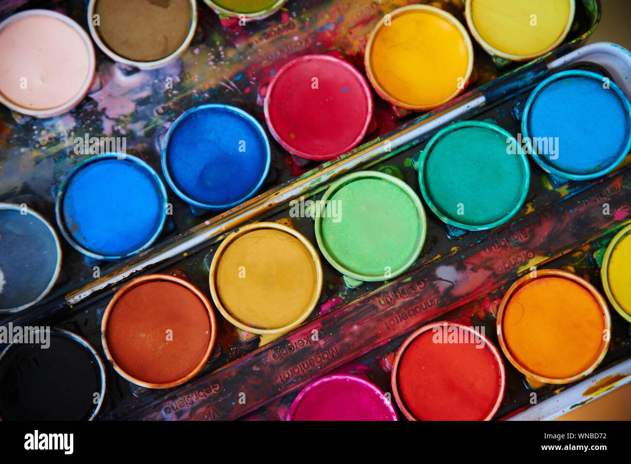 Close-up Of Watercolor Paint And Brush Stock Photo