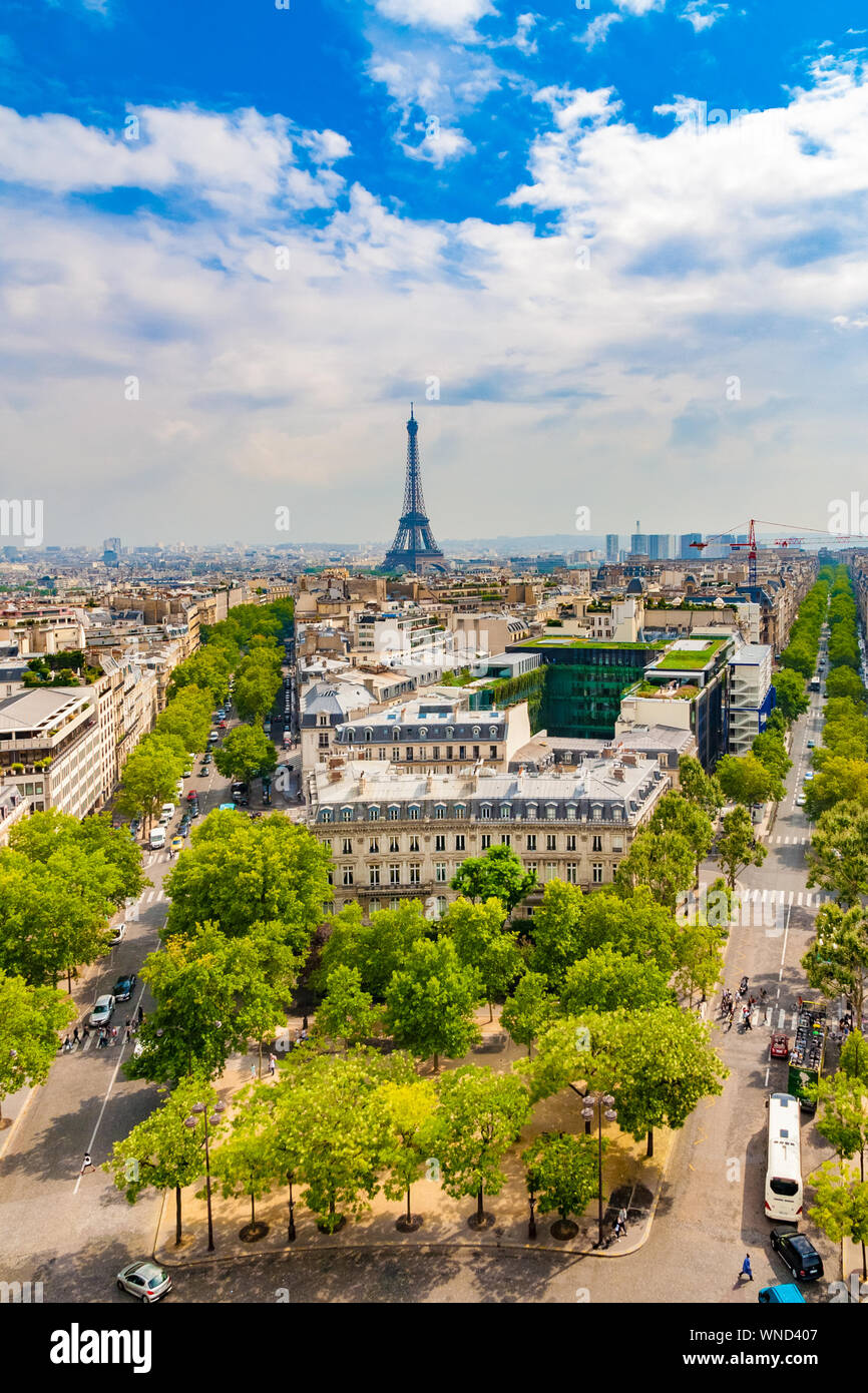 Lovely aerial portrait view of the Paris cityscape on a nice sunny day with the famous and iconic Eiffel Tower in the centre, the Avenue d'Iéna on the... Stock Photo