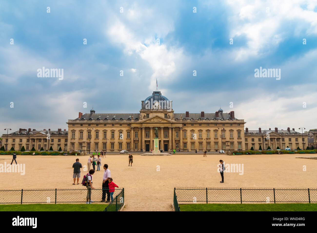 Lovely view of people standing in front of the École Militaire, a military school in the 7th arrondissement of Paris, France, southeast of the Champ... Stock Photo