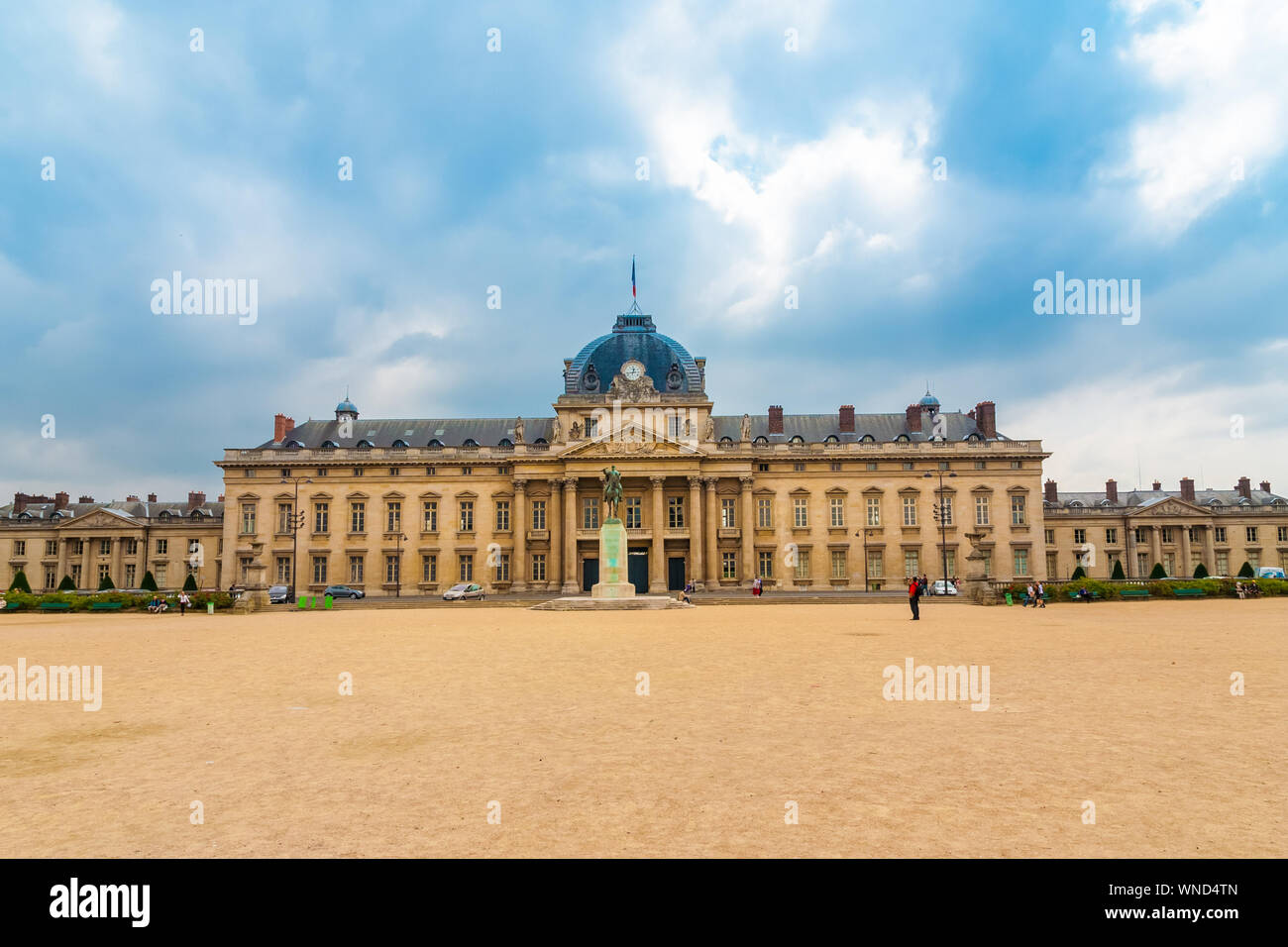 Great panoramic view of the École Militaire (military school) in Paris at the opposite end of the Champ-de-Mars park on a cloudy day. Today it houses... Stock Photo