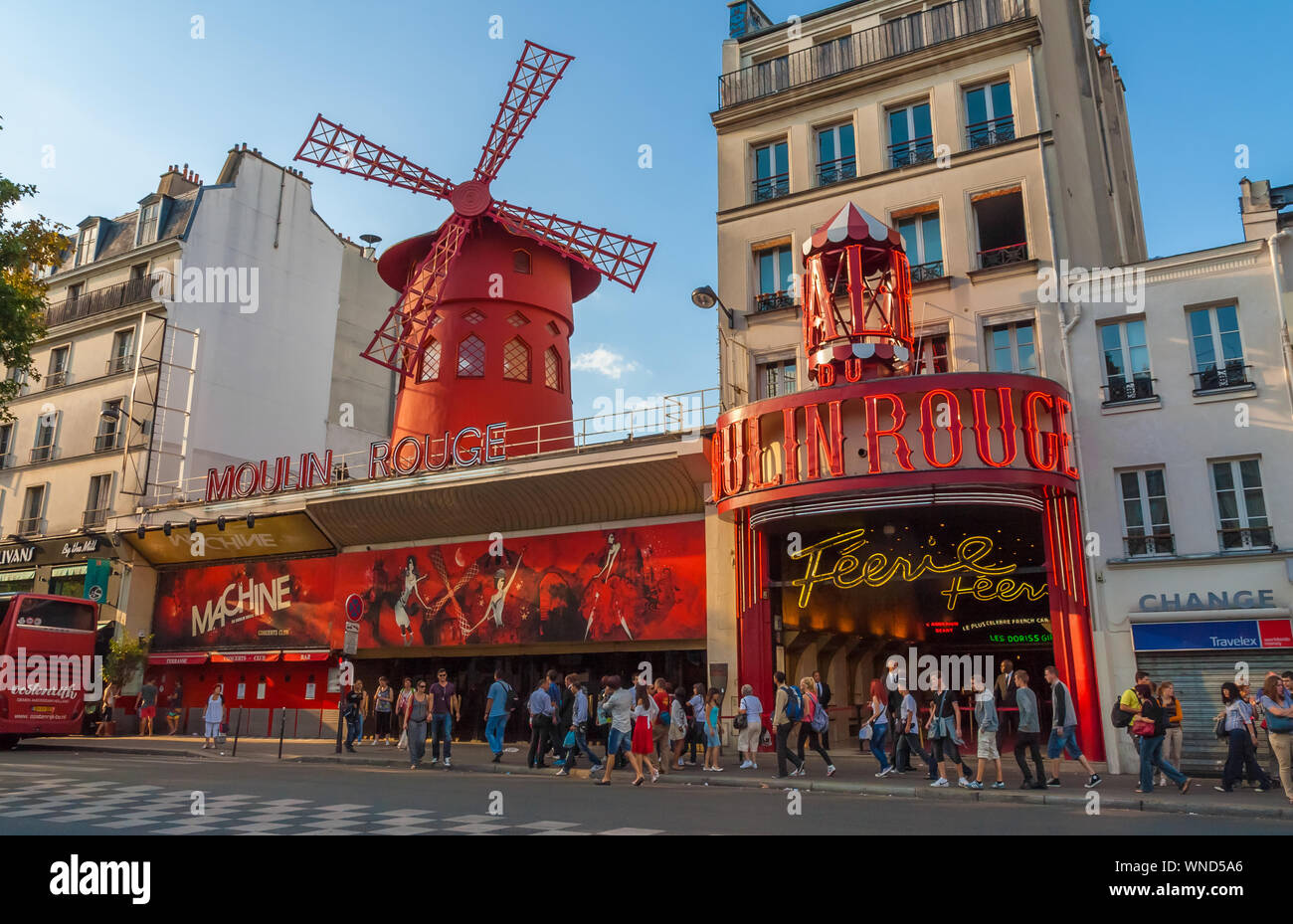 Lovely view of the Moulin Rouge building in the Paris district of Pigalle on Boulevard de Clichy in the 18th arrondissement, marked by a red windmill... Stock Photo